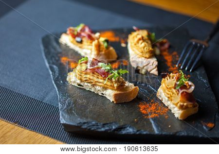 Mini sandwiches with pate in the restaurant. Restaurant food concept.