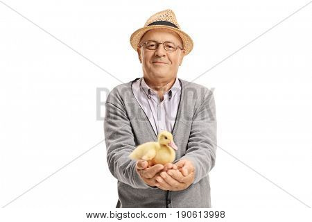 Elderly man with a small duckling looking at the camera isolated on white background