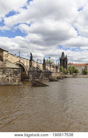 Charles Bridge on Vltava river in sunny day Prague Czech Republic