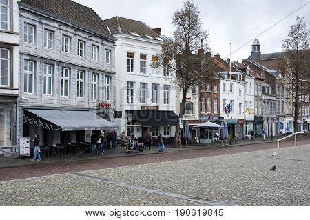 MAASTRICHT NETHERLANDS - FEBRUARY 20 2016: Street in the historical center of Maastricht a city and a municipality in the southeast of the Netherlands