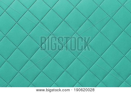 detail of sewn leather turquoise leather upholstery background pattern