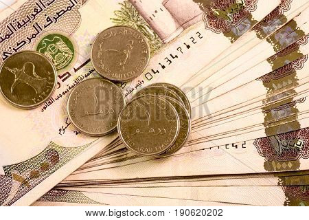 Close up Dirhams currency note and coins, AED, United Arab Emirates