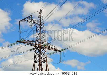 Electrical transmission pylon. High voltage. Blue sky background.