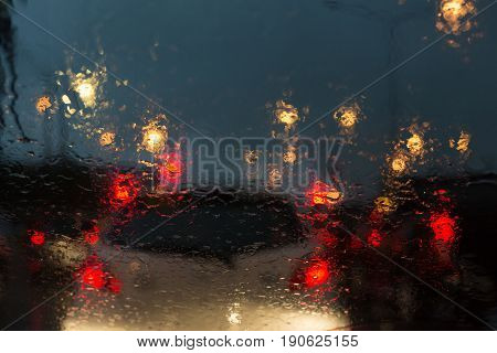 traffic jam in heavy rainy day on city street at night abstract blur image defocused background