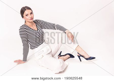 One Young Caucasian Smiling Woman 20S, 20-29 Years, Fashion Model, Posing Sitting White Background,