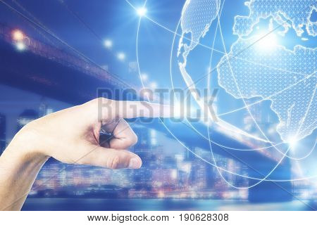 Man's hand pointing at digital globe on nigth city background. Travel concept. 3D Rendering