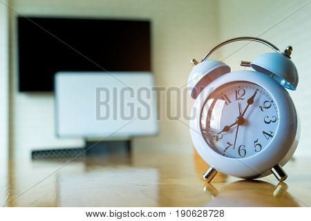 Blue clock at 8.00 am on the meeting room table.