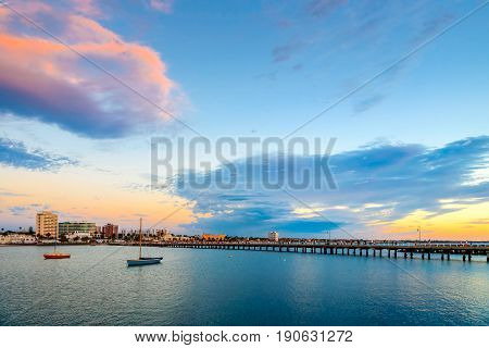 Evening view of St. Kilda Beach jetty at sunset on a hot summer day Melbourne Victoria