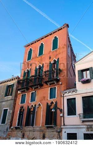Venice, Italy, May, 31, 2017: facade of an inhabitable house at sunrise in Venice, Italy