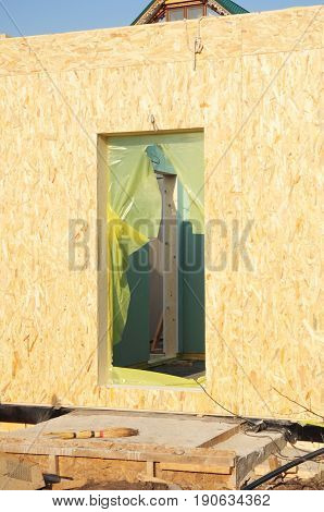 Frame House Door Structural Insulated Panel - SIP. Insulation House. Door installation.