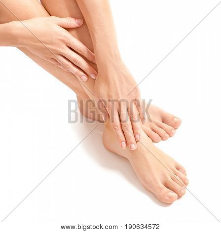 Female hands and legs on white background