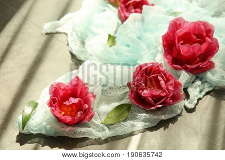 Composition of beautiful tulips on grey surface
