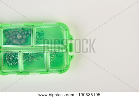 Close up of fishing plastic box. Cropped image of closed box with fishing tools.