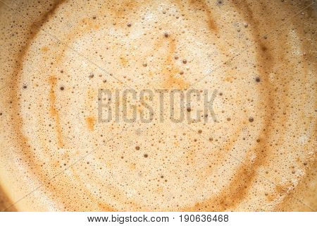 Close up image of hot coffee in white muck
