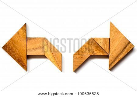 Wooden tangram puzzle in directional arrow shape on white background (Concept of making decision)