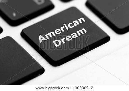 Text AMERICAN DREAM on keyboard button, closeup