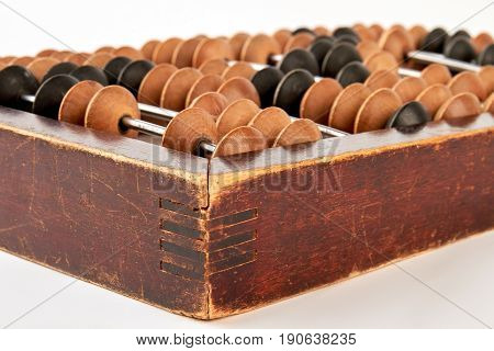 Old wooden scratched abacus. Retro accounting abacus, white background.