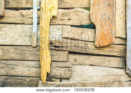 Scruffy wooden background and deteriorated construction material - Texture on multicolored wood panel in alternative structure design - Retro backdrop pattern with vintage saturated filtered look