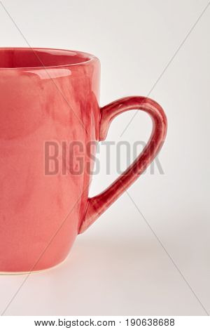 Vertical cropped image of mug. Dishware for drink on white background.