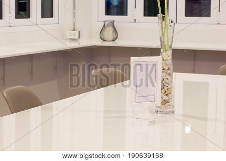 white room with blank sign on the table