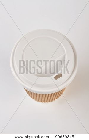 Disposable coffee cup, top view. Paper cup isolated on white.