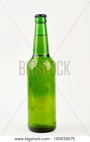 Empty bottle for beer isolated. Green glass bottle, white background.