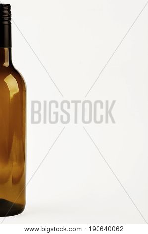 Half of dark bottle isolated. Cropped image of glass bottle.