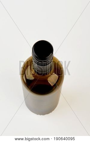Brown glass bottle, top view. Empty container for wine isolated.