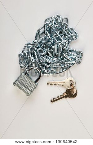 Metallic chain, lock and keys. Security equipment on white background.