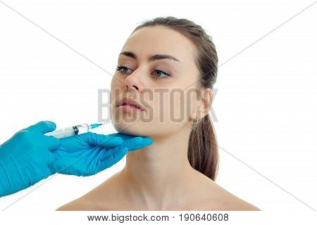 the woman at the plastic surgeon does prick isolated on white background