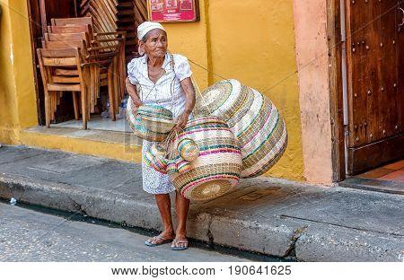 Cartagena, Colombia- March 2, 2017: Baskets street vendors in Cartagena Colombia