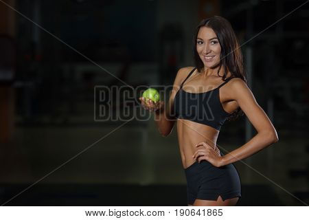 Proper Nutrition Concept Female Athlete With Apple