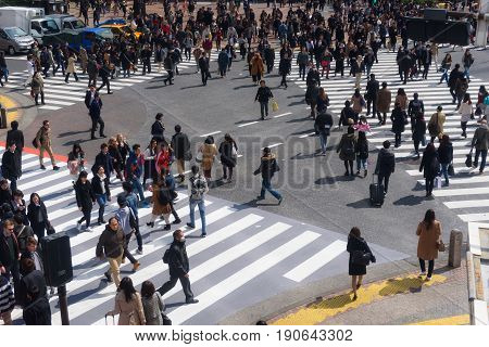 TOKYO JAPAN - MARCH 24 2017: Unidentified people on the street in Shibuya Tokyo. Shibuya is one of fashion centers for teenage people.