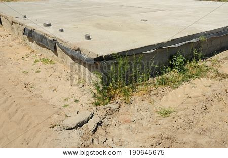 Slab-on-grade foundation with waterproofing. Monolithic slabs are foundation systems constructed as one single concrete pour. Types of foundations. Bitumen waterproof membrane.