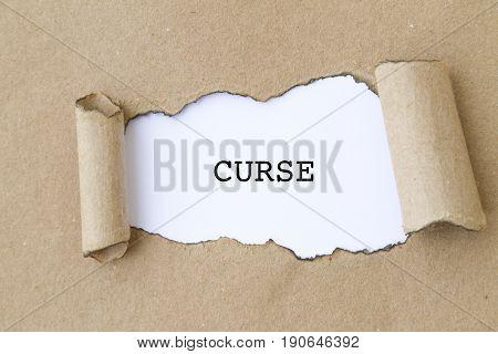 Curse word written under torn paper concept .