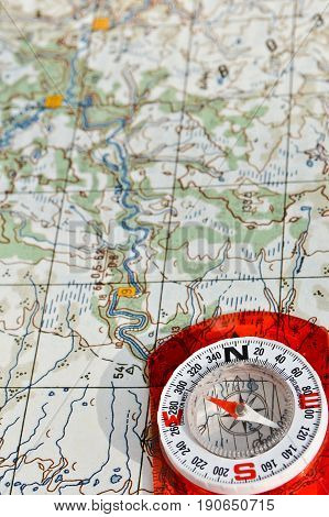 Compass on the map. Navigation tools to avoid getting lost.