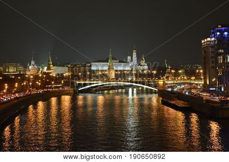 Moscow river and the Moscow Kremlin. City landscape of the Russian capital at night.
