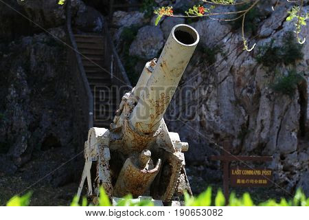 Old Japanese cannon at the Last Command Post, Saipan The relics of a Japanese canon displayed at the Last Command Post in Marpi, northern part of Saipan is one of the top tourist attractions