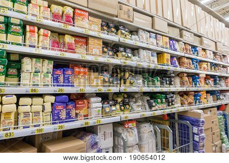 RUSSIA, MOSCOW, JUNE 11, 2017: Different types of ereals on the shelves in the supermarket Auchan.