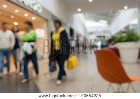 Abstract blurred background people shopping for diverse products in supermarket