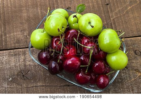 Cherry and green plums in wonderful looking dish, cherry and plums in summer fruit