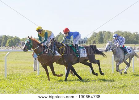 STOCKHOLM SWEDEN - JUNE 06 2017: Tough fight between three jockeys riding gallop arabian race horses at Nationaldags Galoppen at Gardet. June 6 2017 in Stockholm Sweden