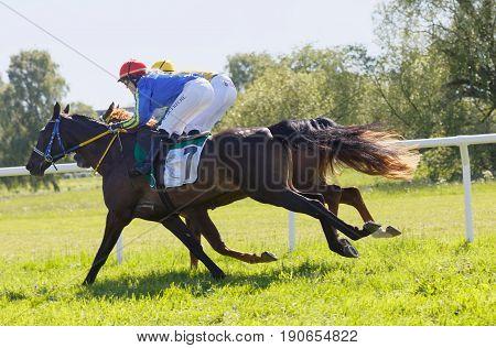 STOCKHOLM SWEDEN - JUNE 06 2017: Tough fight between two jockeys riding gallop arabian race horses at Nationaldags Galoppen at Gardet. June 6 2017 in Stockholm Sweden