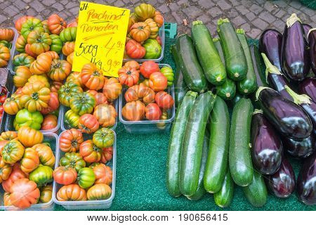 Tomatoes, eggplant and zucchini for sale at a market