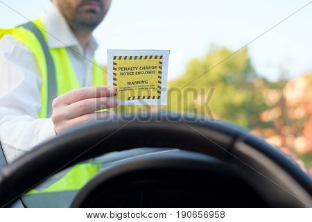 Police officer giving a ticket fine for parking violation