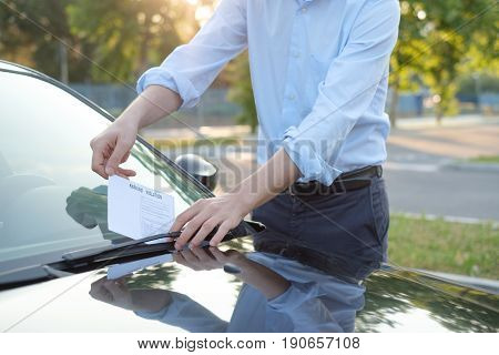 Man finding a ticket fine because of parking violation poster
