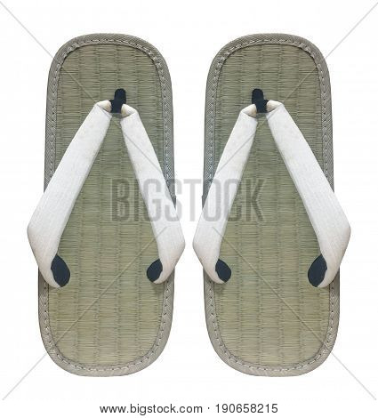 A pair of japanese grass weave shoes in japanese name as TATAMI shoes or GETA shoes isolated on white background