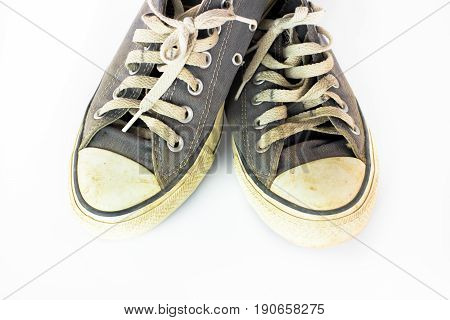 close up Dirty shoe on isolate white background close up shoedirty blue shoes on the white background canvas blue shoes old shoesneaker shoe
