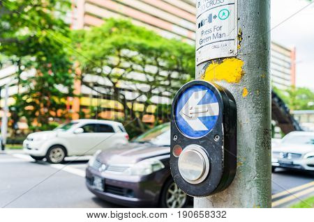 Button for traffic light and Cars in background. Traffic lights at the crossroads. Button of the mechanism lights traffic lights on the street. System control traffic light intersection close.