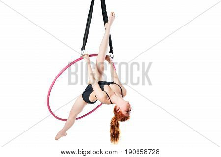 Flexible Slender Girl Exercising In An Air Ring On A White Background
